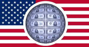 A zoom in of dollar bills in a American Flag