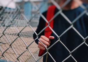 boy in fencing, immigration attorney