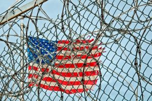 iron net with an American flag, Deportation