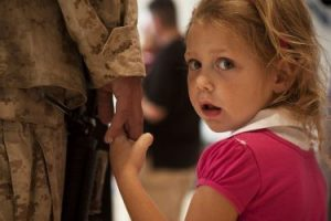 A solider with his daughter