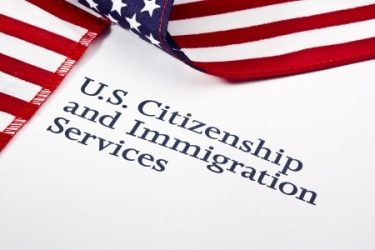 U.S. Citizenship and Immigration Services with U.S. flag