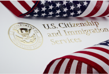 U.S. Citizenship and Immigration Services file and and American flag