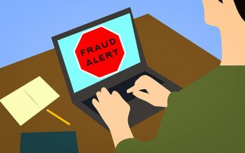 Fraud alert shows on a person's computer