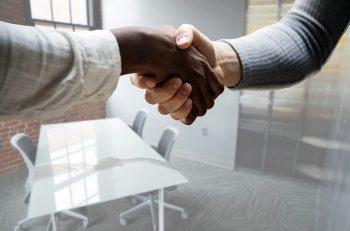 Handshake in a meeting room